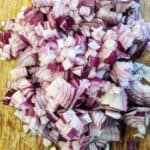 Chopped red onions on a wooden board