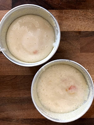 Two bowls of sponge cake mix
