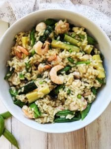 A white bowl of shrimp risotto
