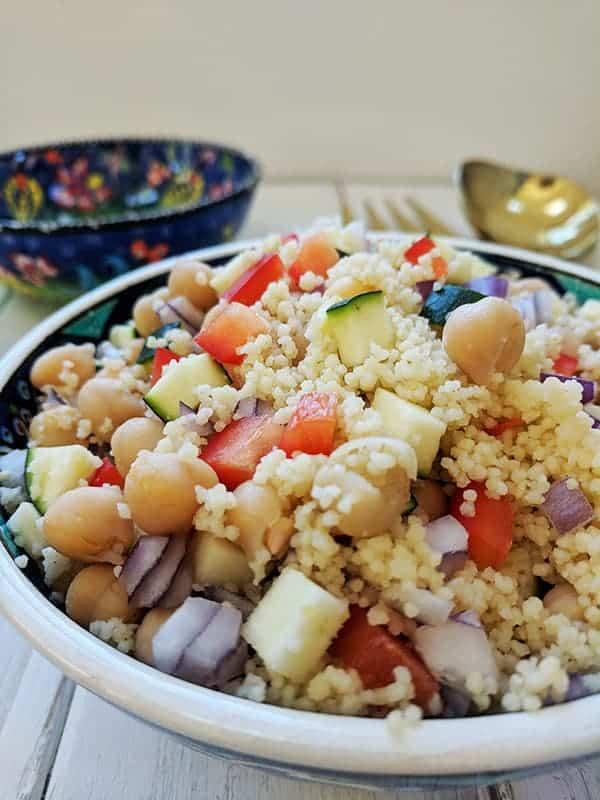 A close up of a bowl of couscous salad