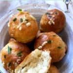 A bowl of garlic topped dough balls
