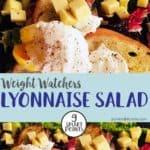 A black plate with lyonnaise salad