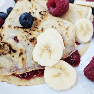A close up of some berry pancakes