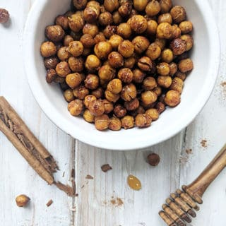 A bowl of honey roasted chickpeas with cinnamon and honey