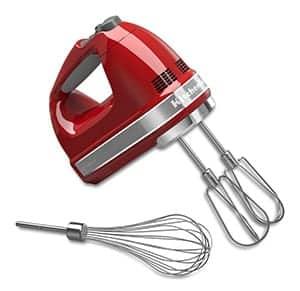 A red KitchenAid hand mixer