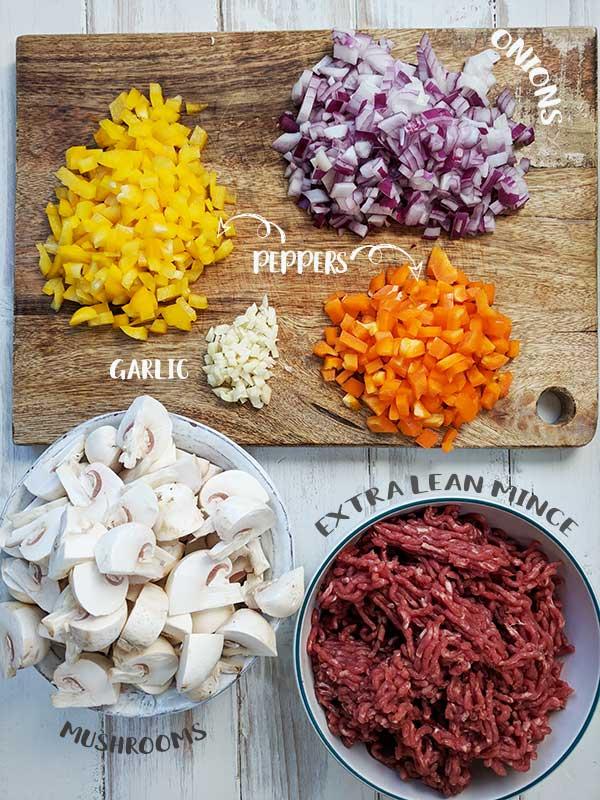 Ingredients to make pasta bolognese bake