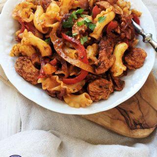 a white bowl of fajita pasta