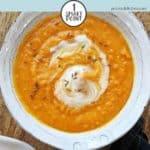 A bowl of carrot & lentil soup