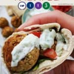 Falafel in a pitta bread with salad and sauce
