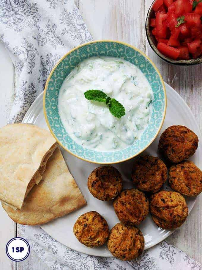 A plate of falafel with tzatziki and pitta