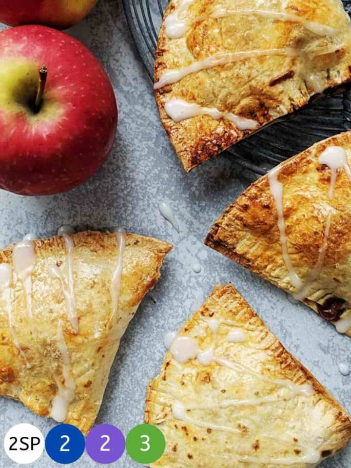 A selection of apple turnovers on a grey background