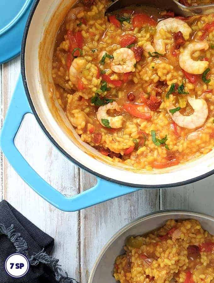 A dish of shrimp, chorizo and red pepper paella