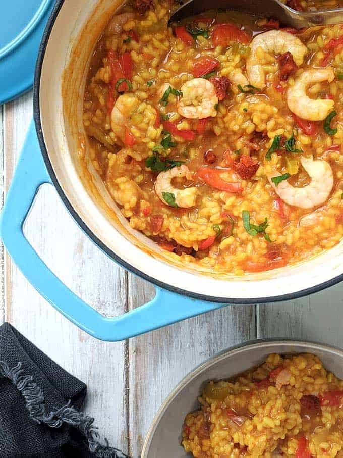 A casserole dish of Shrimp, chorizo and red pepper paella | weight watchers
