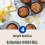 Banana Muffins on a wire rack with a peeled banana along side