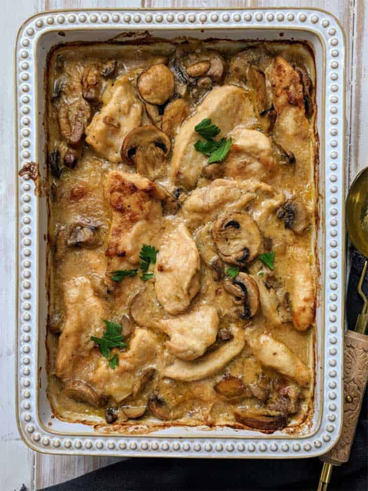 Creamy chicken casserole in a ceramic dish