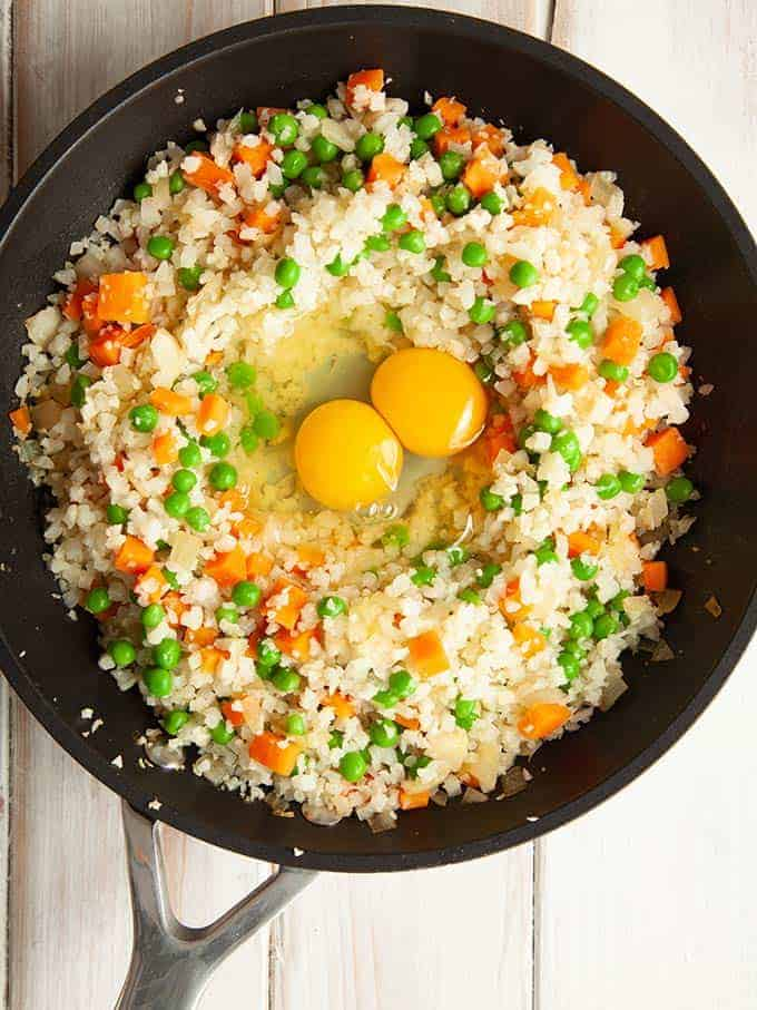A skillet of egg fried cauliflower rice