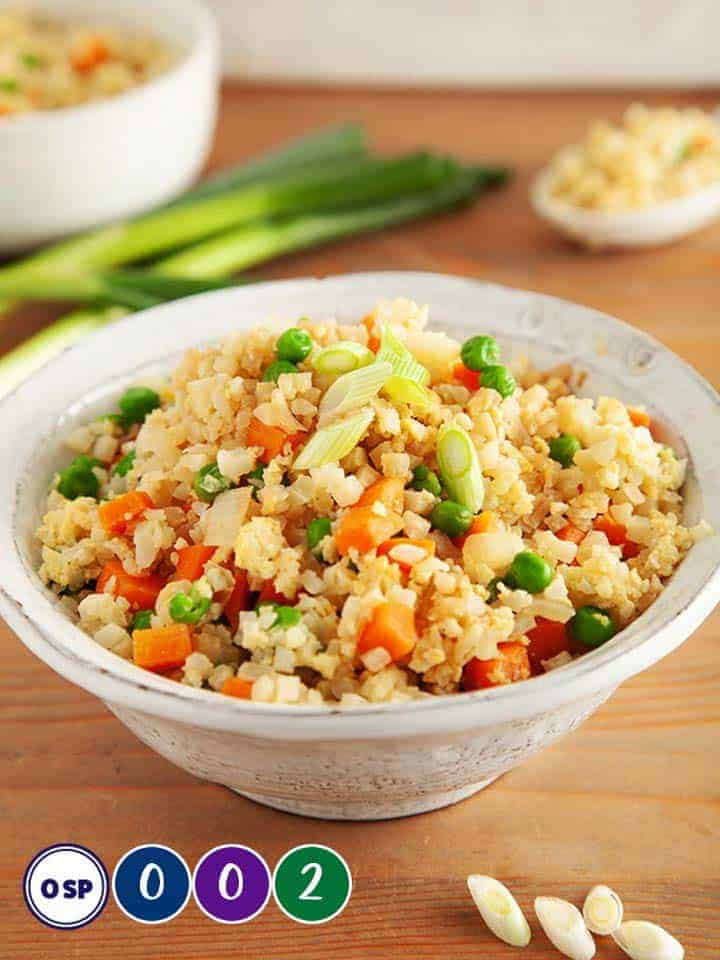 A dish of cauliflower egg fried rice.