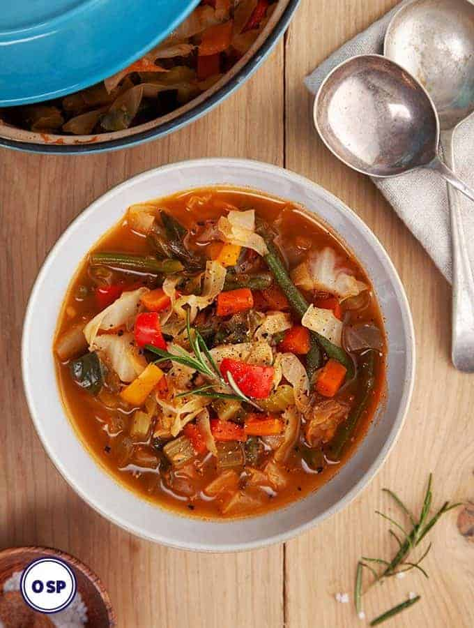 A bowl of cabbage soup on a wooden table | weight watchers