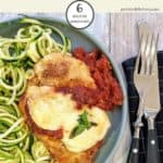 A plate of chicken parmesan with zucchini noodles