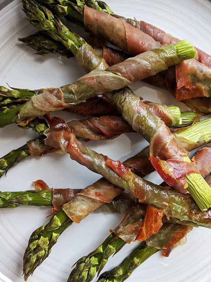 A close up shot of some prosciutto wrapped asparagus