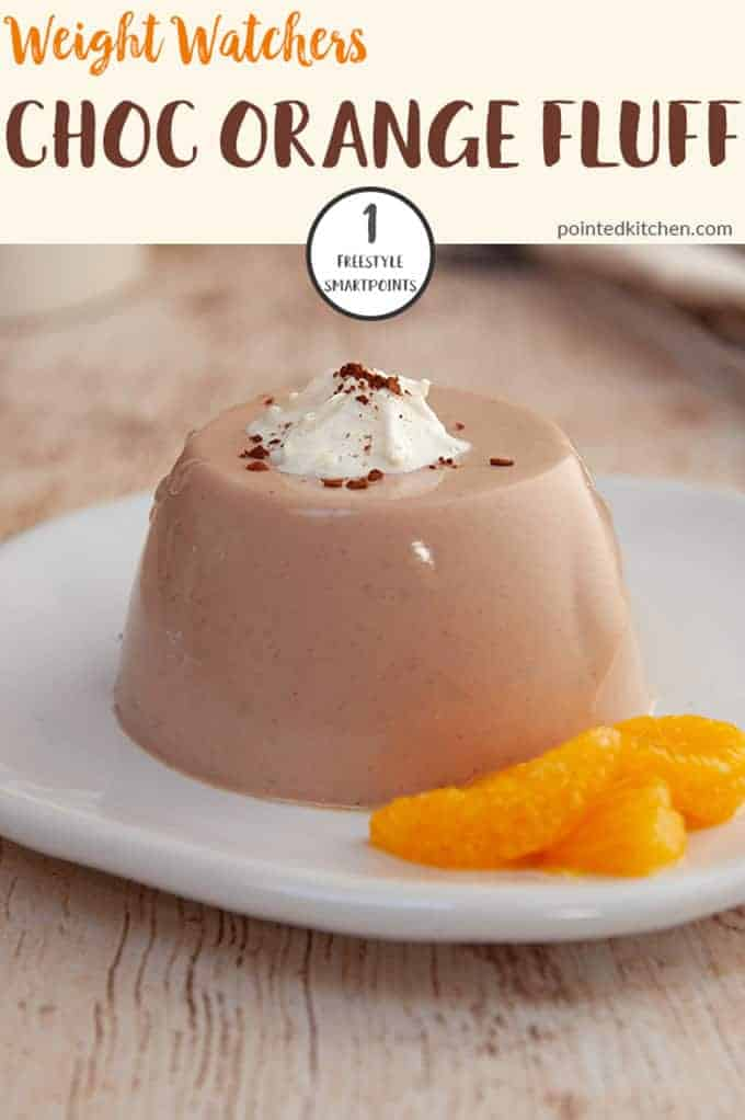 A white plate with chocolate orange fluff and some sliced mandarin slices