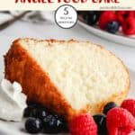 A slice of pineapple angel food cake with berries and cream
