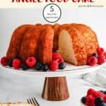 A pineapple angel food cake on a cake stand