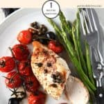 Balsamic chicken with asparagus on a white plate with cutlery