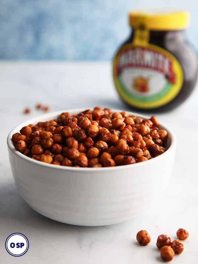 A bowl of marmite flavoured chickpeas in a white bowl.