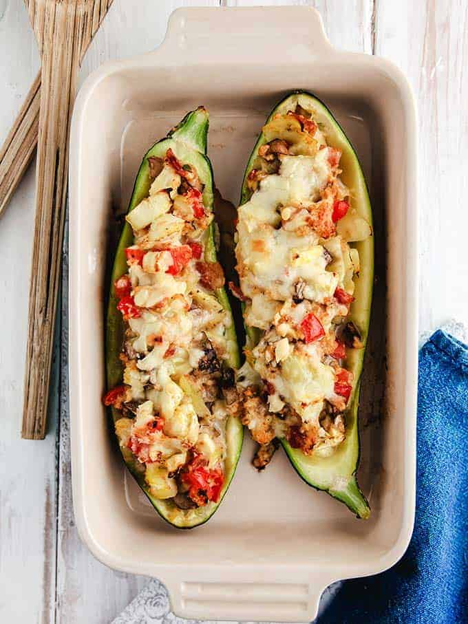 A dish of stuffed zucchini on a white table