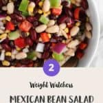 A white bowl of Mexican bean salad