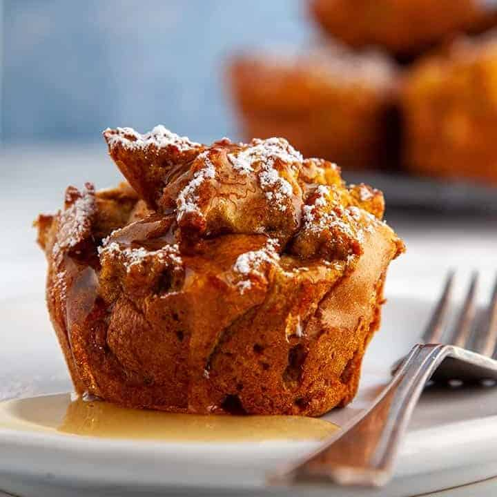 Pumpkin spiced french toast muffin with syrup on a white plate