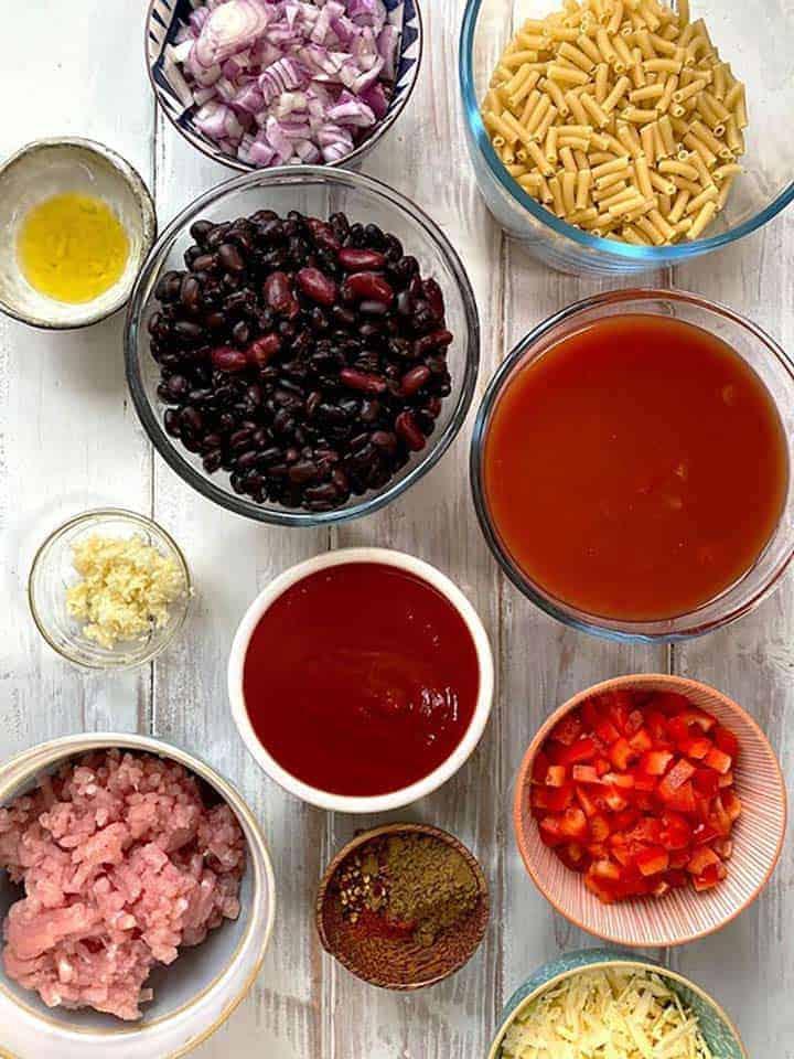 Ingredients to make turkey chili mac and cheese on a white table