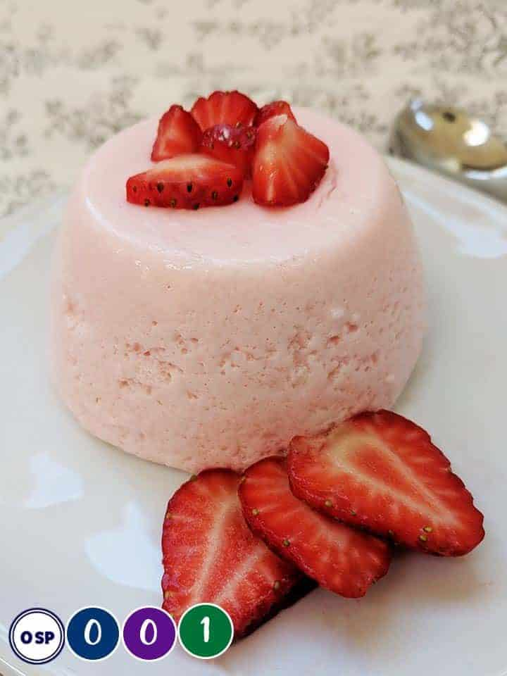 A Weight Watchers Fluff dessert on a white plate with strawberries