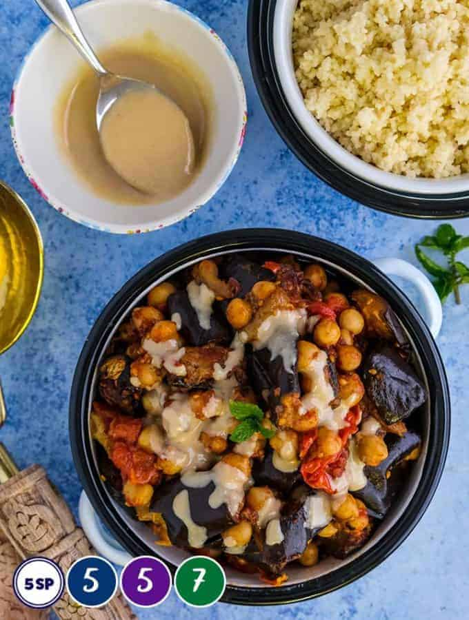 A dish of eggplant and chickpea stew with couscous