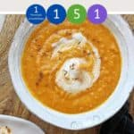 Carrot and lentil soup in a bowl on a table