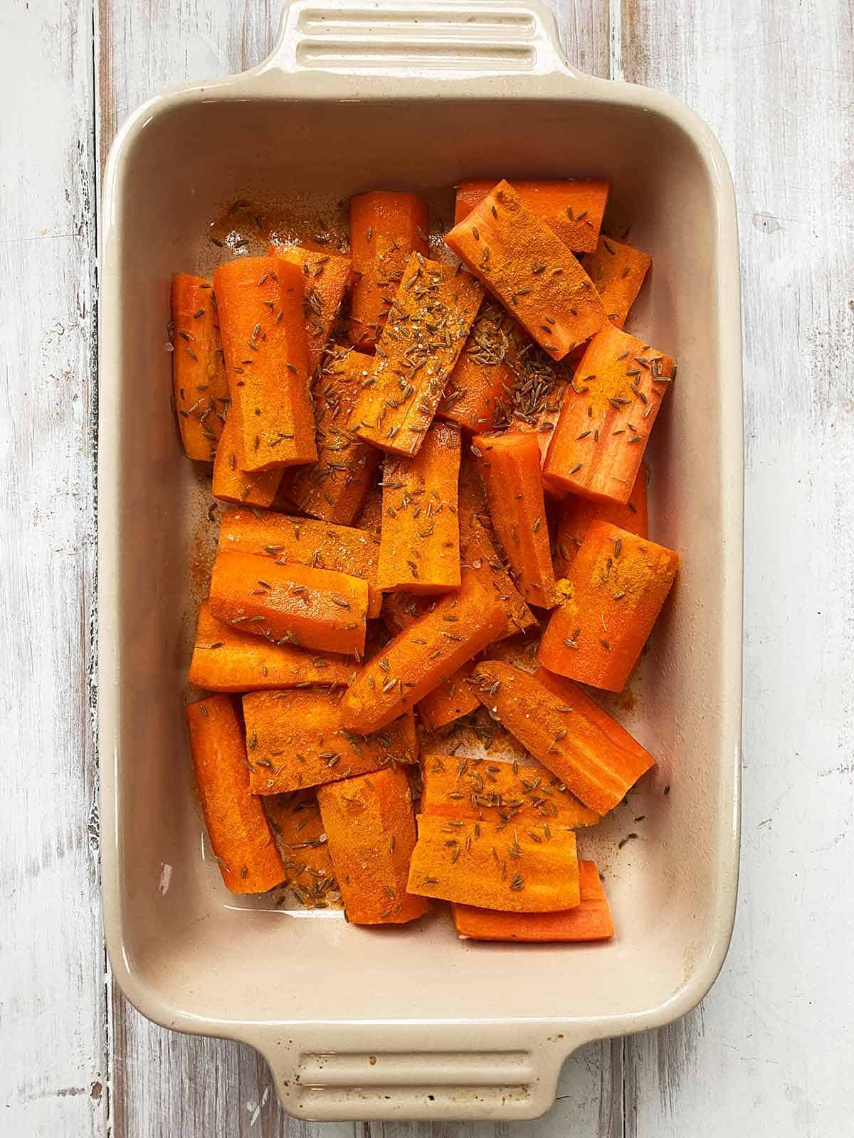 A dish of chopped carrots with cumin seeds