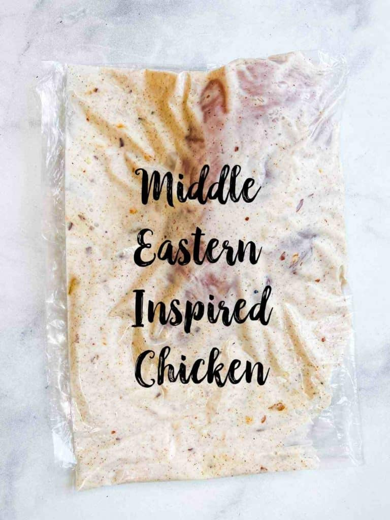 A plastic bag with a chicken breast and marinade with text overlay