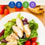 A white dish with salad and sliced chicken with text overlay with WW points and 'yogurt chicken'.
