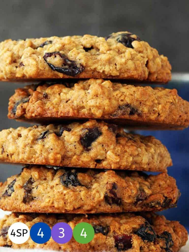 Five oat and raisin cookies stacked on top of one another with SmartPoint totals.