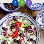 Greek Salad in a blue and white bowl with title text overlay and smartpoint values.