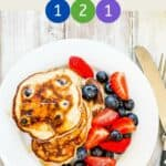 A plate of pancakes with mixed berries with text overlay 'Weight Watchers Kodiak Pancakes'.