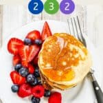 A white plate of pancakes and berries with text overlay stating Weight Watchers Fluffy Pancakes.