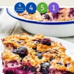 Baked oatmeal on a white plate with text overlay stating Baked Oats with Blueberries Weight Watchers.
