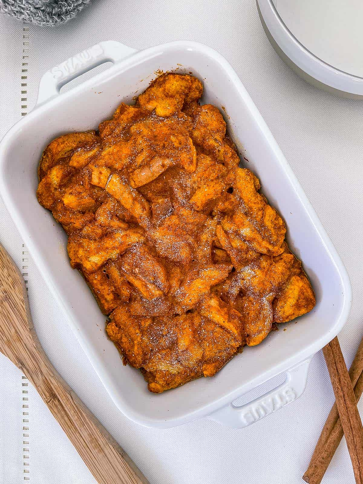 A dish of Weight Watchers Pumpkin Spice French Toast Casserole on a white tablecloth.